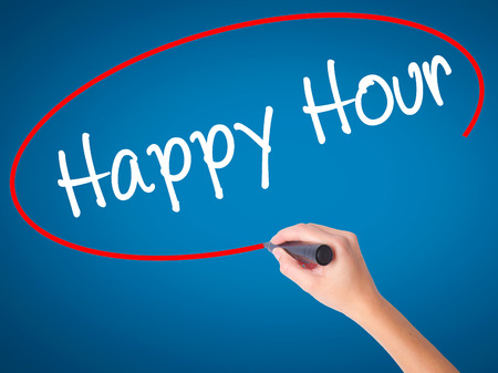happyhour: Women Hand writing Happy Hour with black marker on visual screen. Isolated on blue. Business, technology, internet concept. Stock Image