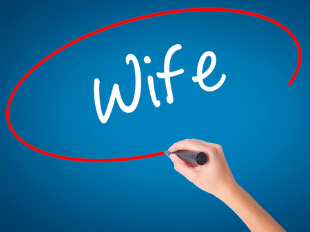 Woman Hand writing Wife with black marker on visual screen. Isolated on background. Business, technology, internet concept. Stock Photo Stock Photo