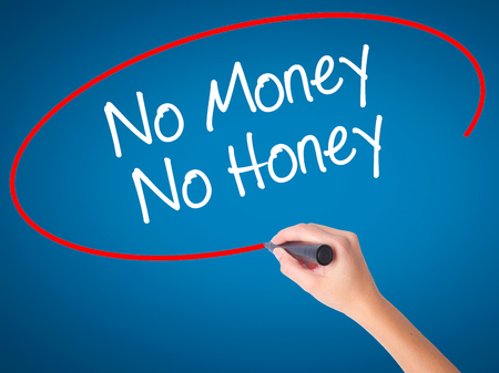 Women Hand writing No Money No Honey with black marker on visual screen. Isolated on blue. Business, technology, internet concept. Stock Photo