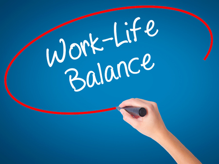 Man Hand writing Work-Life Balance with black marker on visual screen. Isolated on white. Business, technology, internet concept. Stock Photo Stock Photo
