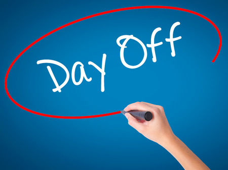 off day: Women Hand writing Day Off  with black marker on visual screen. Isolated on blue. Business, technology, internet concept. Stock Photo