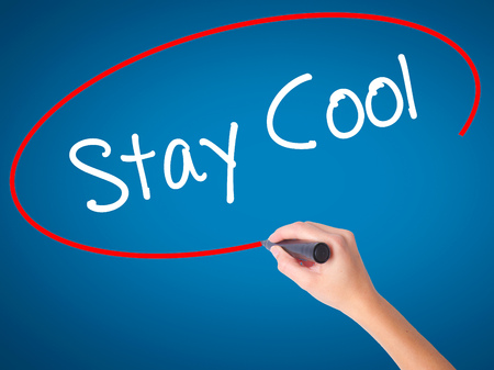 Women Hand writing Stay Cool   with black marker on visual screen. Isolated on blue. Business, technology, internet concept. Stock Photo