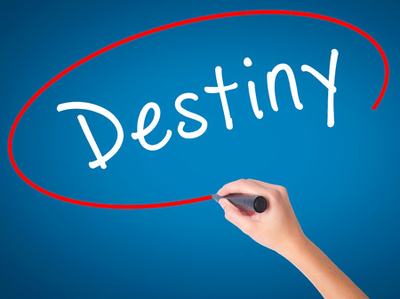 destiny: Women Hand writing Destiny black marker on visual screen. Isolated on blue. Business, technology, internet concept. Stock Image