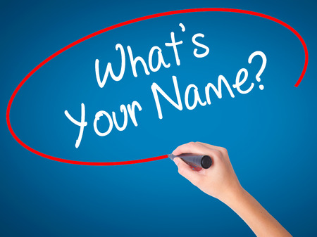 Man Hand writing Whats your Name? with black marker on visual screen. Isolated on background. Business, technology, internet concept. Stock Photo