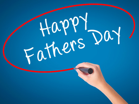 Man Hand writing Happy Fathers Day with black marker on visual screen. Isolated on white. Business, technology, internet concept. Stock Image