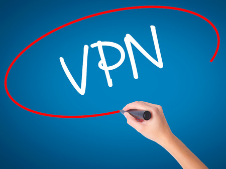 vpn: Women Hand writing VPN (Virtual Private Network) with black marker on visual screen. Isolated on blue. Business, technology, internet concept. Stock Photo Stock Photo