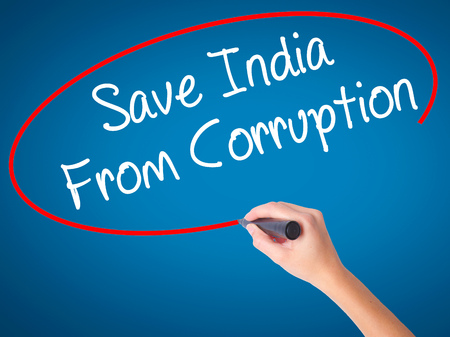 marchers: Women Hand writing Save India From Corruption with black marker on visual screen. Isolated on blue. Business, technology, internet concept. Stock Photo