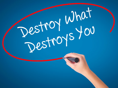annihilate: Women Hand writing Destroy What Destroys You with black marker on visual screen. Isolated on blue. Business, technology, internet concept. Stock Photo Stock Photo