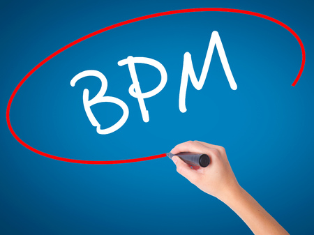 bpm: Women Hand writing  BPM (Business Process Management) with black marker on visual screen. Isolated on blue. Business, technology, internet concept. Stock Photo
