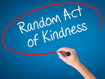 Women Hand writing Random Act of Kindness with black marker on visual screen. Isolated on blue. Business, technology, internet concept. Stock Photo