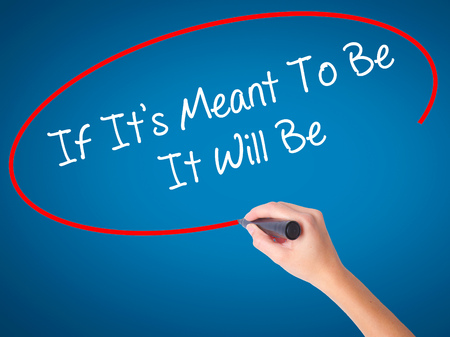 meant: Women Hand writing If Its Meant To Be It Will Be with black marker on visual screen. Isolated on blue. Business, technology, internet concept. Stock  Photo Stock Photo