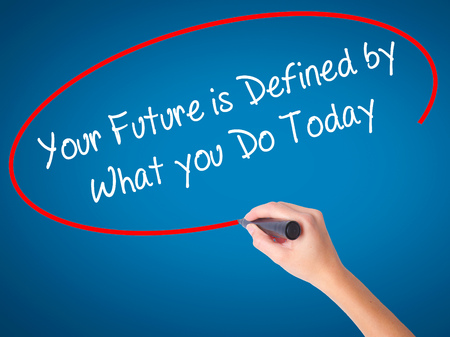 Man Hand writing Your Future is Defined by What you Do Today  with black marker on visual screen. Isolated on white. Business, technology, internet concept. Stock Photo Stock Photo