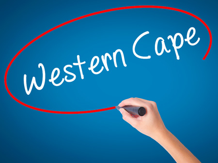 writing western: Man Hand writing Western Cape with black marker on visual screen. Isolated on background. Business, technology, internet concept. Stock Photo