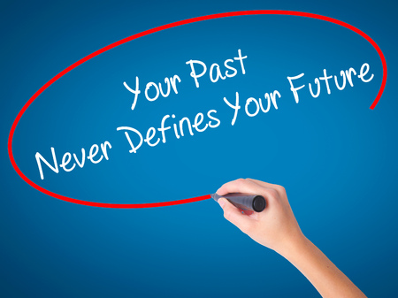defines: Man Hand writing Your Past Never Defines Your Future with black marker on visual screen. Isolated on white. Business, technology, internet concept. Stock Photo Stock Photo