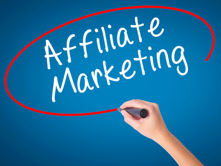 affiliation: Man Hand writing Affiliate Marketing with black marker on visual screen. Isolated on white. Business, technology, internet concept. Stock Image