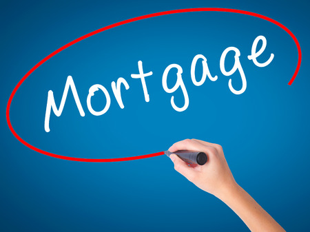 Man Hand writing Mortgage with black marker on visual screen. Isolated on white. Business, technology, internet concept. Stock Image