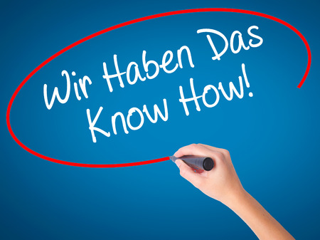 Man Hand writing Wir Haben Das Know How! (We Have the Know-How in German)  with black marker on visual screen. Isolated on background. Business, technology, internet concept. Stock Photo