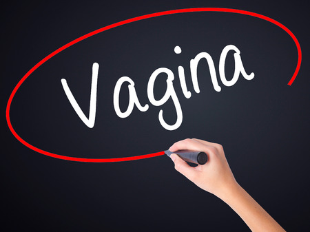 mammogram: Woman Hand Writing Vagina on blank transparent board with a marker isolated over black background. Stock Photo