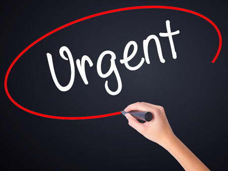 demanded: Woman Hand Writing Urgent  with a marker over transparent board . Isolated on background. Business, technology, internet concept. Stock  Photo Stock Photo