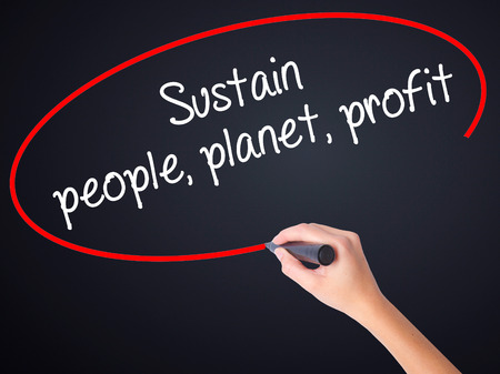 sustain: Woman Hand Writing Sustain, people, planet, profit on blank transparent board with a marker isolated over black background. Business concept. Stock Photo