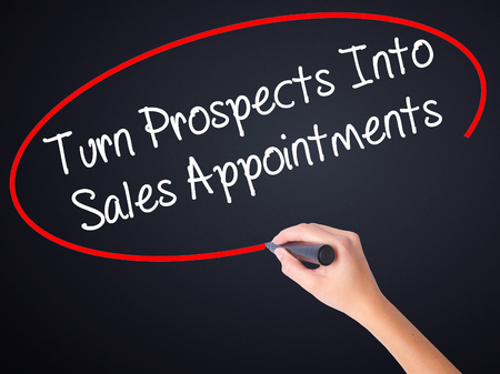 prospecting: Woman Hand Writing Turn Prospects Into Sales Appointments with a marker over transparent board . Isolated on background. Business, technology, internet concept. Stock  Photo
