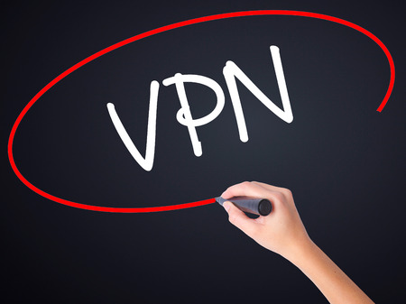 vpn: Woman Hand Writing VPN (Virtual Private Network) on blank transparent board with a marker isolated over black background. Stock Photo Stock Photo