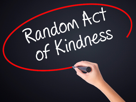 helpfulness: Woman Hand Writing Random Act of Kindness on blank transparent board with a marker isolated over black background. Business concept. Stock Photo