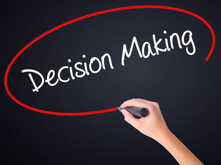 tree service business: Woman Hand Writing Decision Making on blank transparent board with a marker isolated over black background. Business concept. Stock Photo