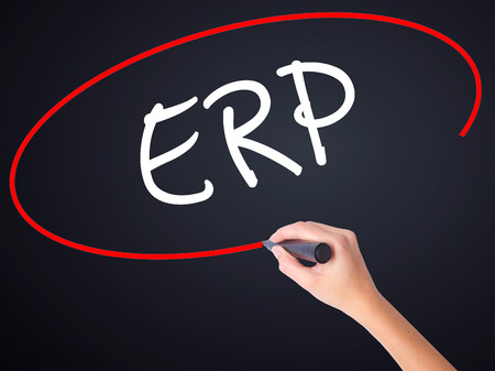 Woman Hand Writing  ERP (Enterprise Resource Planning)   on blank transparent board with a marker isolated over black background. Stock Photo