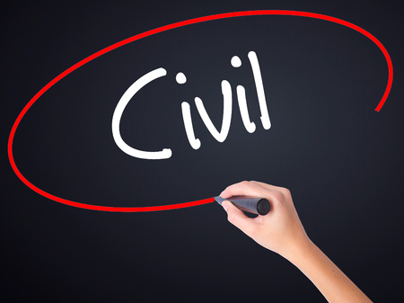 Woman Hand Writing Civil on blank transparent board with a marker isolated over black background. Stock Photo Stock Photo