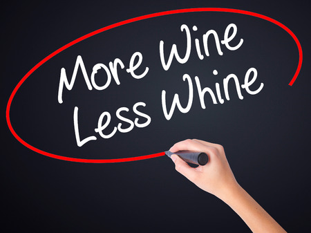 whine: Woman Hand Writing More Wine Less Whine on blank transparent board with a marker isolated over black background. Business concept. Stock Photo Stock Photo