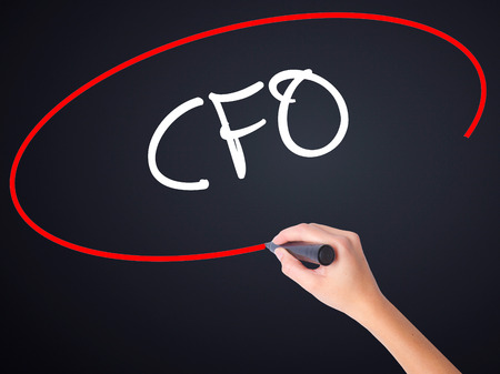 comité d entreprise: Woman Hand Writing CFO (Chief Financial Officer) on blank transparent board with a marker isolated over black background. Stock Photo