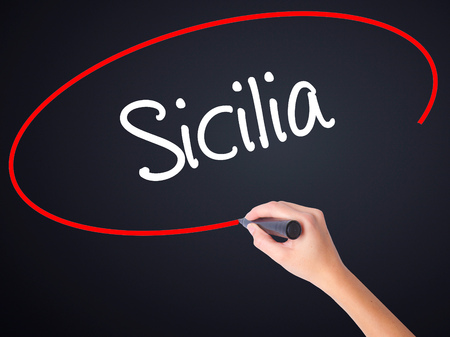 ner: Woman Hand Writing Sicilia (Sicily In Italian)  with a marker over transparent board . Isolated on sky. Business, technology, internet concept. Stock Photo Stock Photo