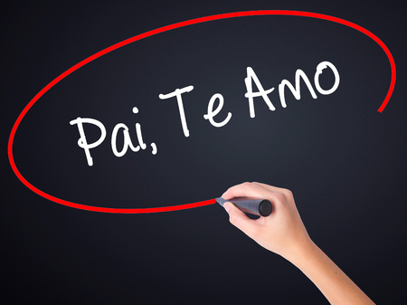te: Woman Hand Writing Pai, Te Amo (In portuguese - Love You, Dad) on blank transparent board with a marker isolated over black background. Business concept. Stock Photo Stock Photo