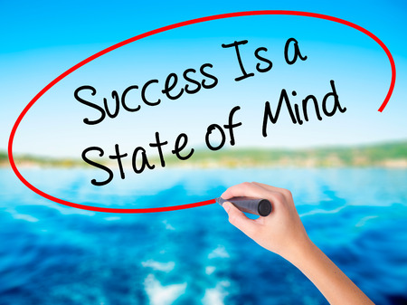 Woman Hand Writing Success Is a State of Mind on blank transparent board with a marker isolated over water background. Business concept. Stock Photo Stock Photo