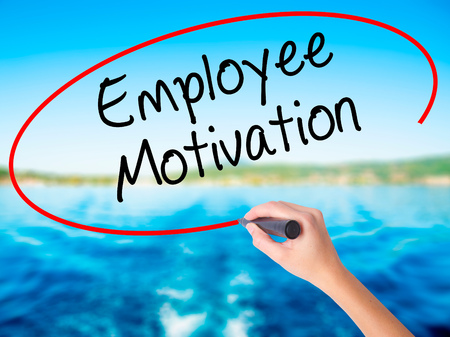 induce: Woman Hand Writing Employee Motivation with a marker over transparent board. Isolated on background. Business, technology, internet concept. Stock  Photo Stock Photo