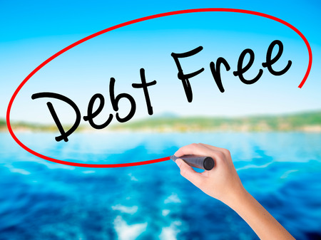 debt goals: Woman Hand Writing Debt Free on blank transparent board with a marker isolated over water background. Business concept. Stock Photo Stock Photo