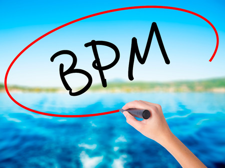 bpm: Woman Hand Writing  BPM (Business Process Management) on blank transparent board with a marker isolated over water background. Business concept. Stock Photo Stock Photo