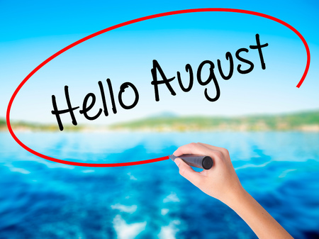 hi back: Woman Hand Writing Hello August on blank transparent board with a marker isolated over water background. Business concept. Stock Photo Stock Photo