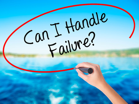 Woman Hand Writing Can I Handle Failure? on blank transparent board with a marker isolated over water background. Business concept. Stock Photo