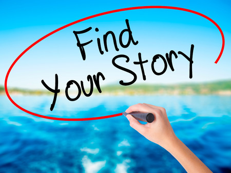 Woman Hand Writing Find Your Story on blank transparent board with a marker isolated over water background. Business concept. Stock Photo