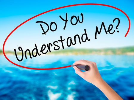 understand: Woman Hand Writing Do You Understand Me? on blank transparent board with a marker isolated over water background. Business concept. Stock Photo