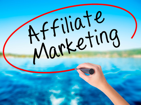 affiliation: Woman Hand Writing Affiliate Marketing on blank transparent board with a marker isolated over water background. Business concept. Stock Photo Stock Photo