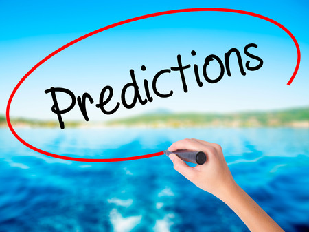 stock predictions: Woman Hand Writing Predictions  on blank transparent board with a marker isolated over water background. Business concept. Stock Photo