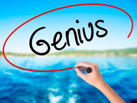 savant: Woman Hand Writing Genius  on blank transparent board with a marker isolated over water background. Business concept. Stock Photo