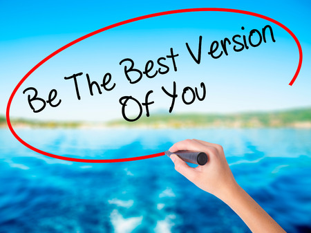 Woman Hand Writing Be The Best Version Of You on blank transparent board with a marker isolated over water background. Business concept. Stock Photo Stock Photo