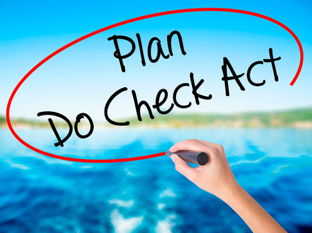 plan do check act: Woman Hand Writing Plan Do Check Act  on blank transparent board with a marker isolated over water background. Business concept. Stock Photo
