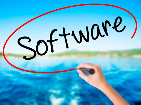 mysql: Woman Hand Writing Software  on blank transparent board with a marker isolated over water background. Business concept. Stock Photo Stock Photo