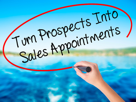 Woman Hand Writing Turn Prospects Into Sales Appointments with a marker over transparent board. Isolated on background. Business, technology, internet concept. Stock  Photo Stock Photo