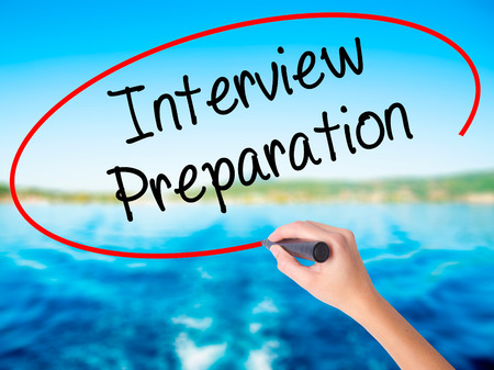 job qualifications: Woman Hand Writing Interview Preparation on blank transparent board with a marker isolated over water background. Business concept. Stock Photo Stock Photo